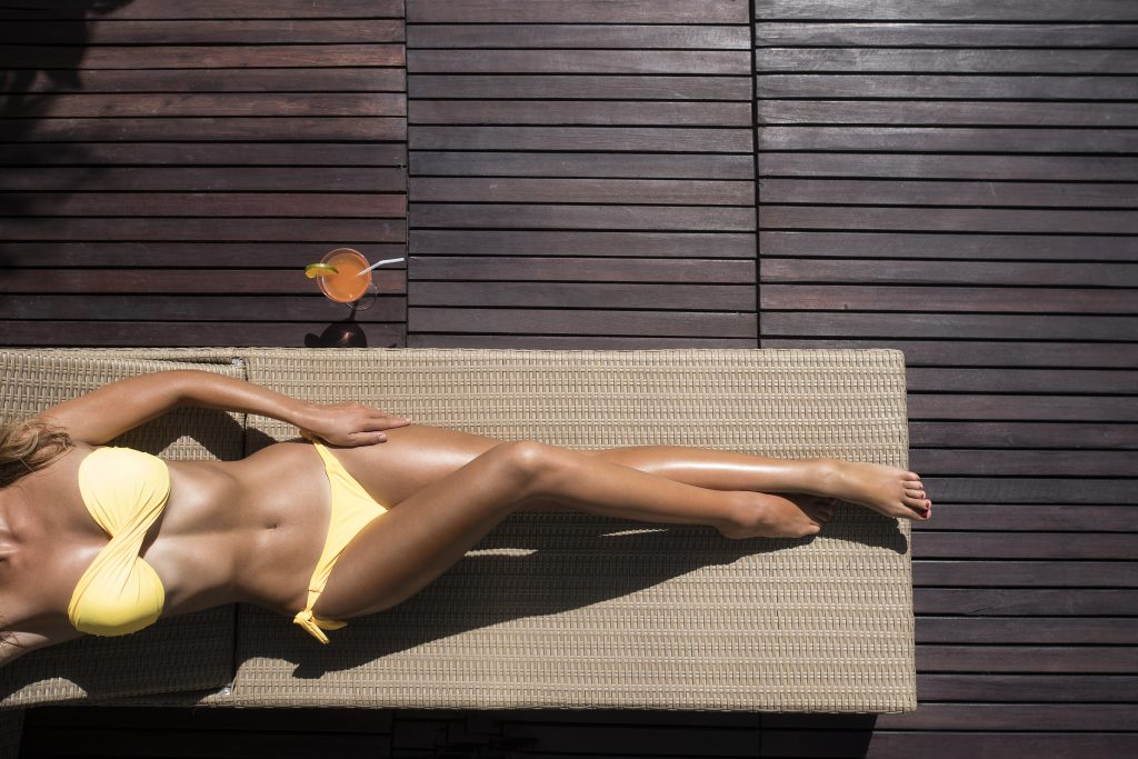 women tanning outside