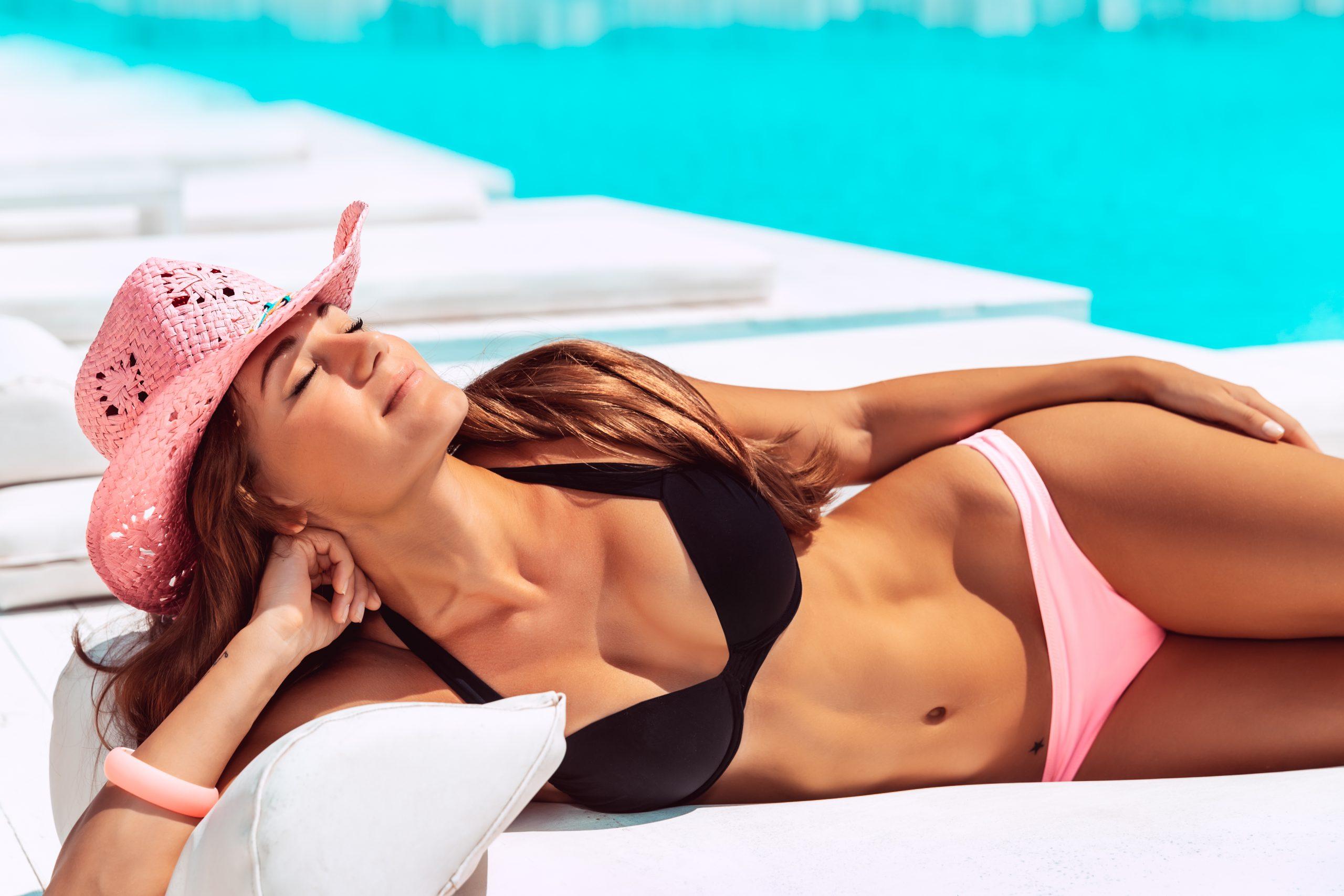 Beautiful Woman Tanning On The Pool